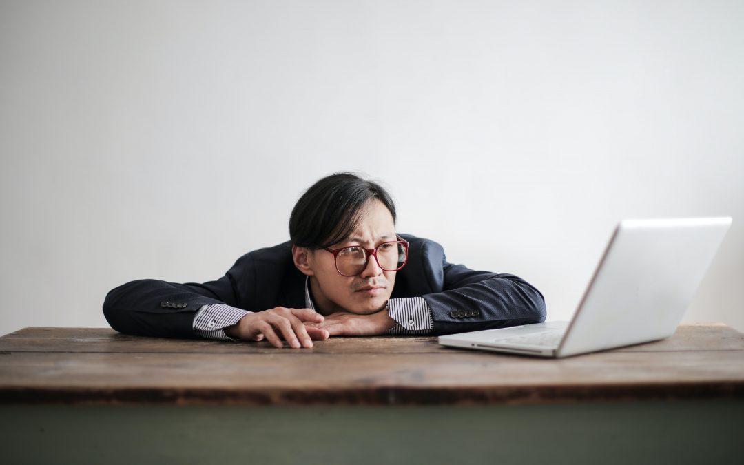 bored man watching laptop